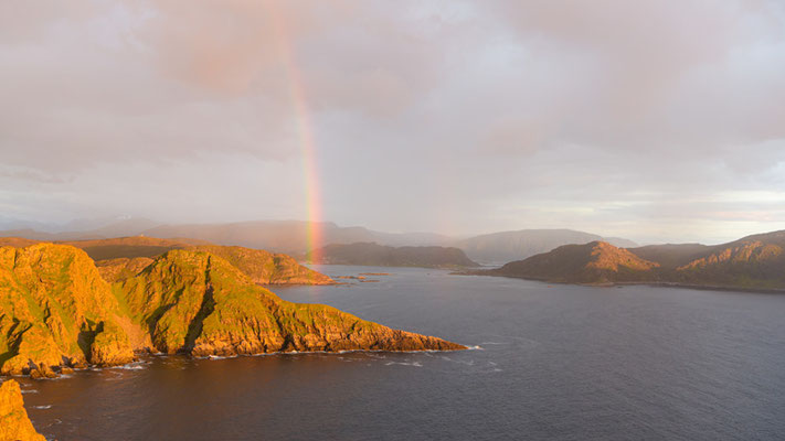 Beautiful rainbow from the top of the cliffs on Runde Island