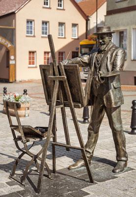 Maler Hans Hartig auf dem Neuwarper Marktplatz