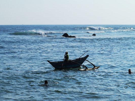 Fischer im Auslegerboot