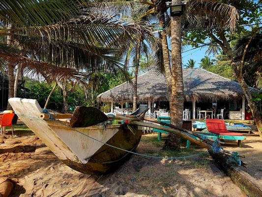 Blick vom Strand zum Restaurant Papa Mango