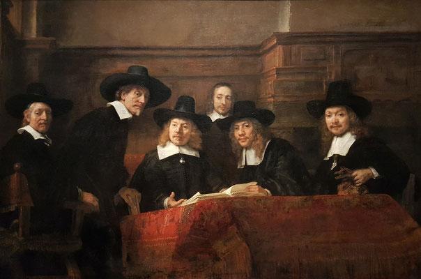 Rembrandt van Rijn: Porträt der Vorsteher der Tuchmacherzunft, Öl auf Leinwand 191,5 × 279 cm, 1662