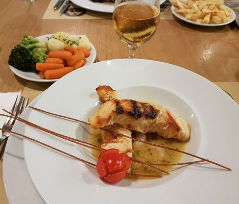 Grilled salmon loin with shrimp and capers served with vegetables