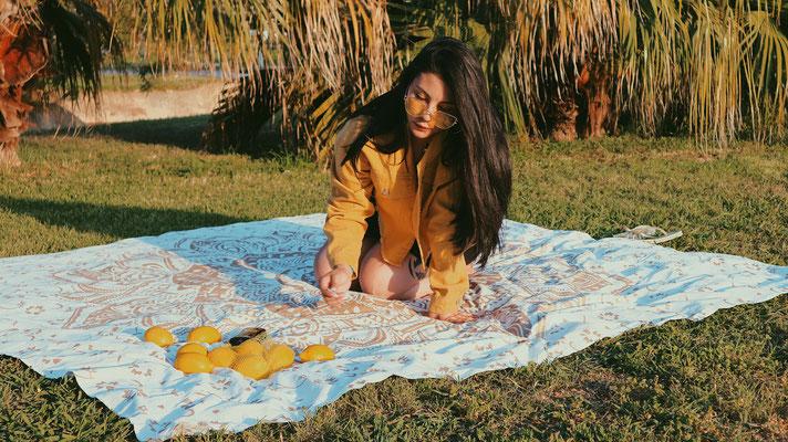 Auch als Picknicktuch lassen sich große Wandtücher ideal verwenden
