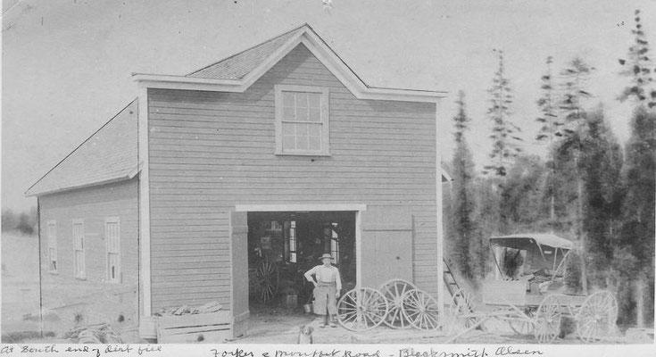 "H.P. Olsen's ""Blacksmith Shop"" in 1909"