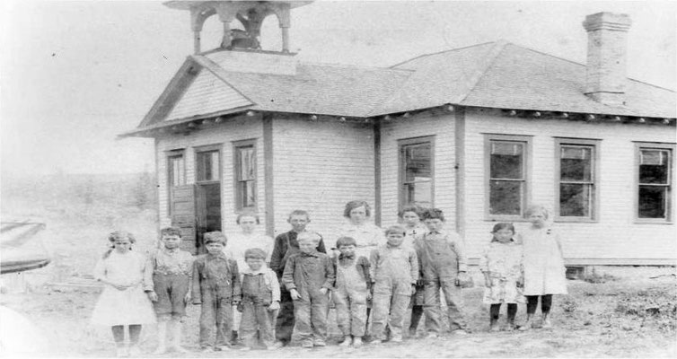 Back to School! The Frog Pond School, 1916, later moved to present location near the Foothills Schoolhouse (Millville School) to become the teachers cottage. Front row: ?, Gordon Hopper, Rollie Lindell, Ernest Hopper, ?, ?, Roy Lindell, John Hopper, Kikua