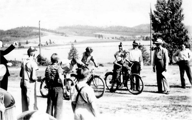 The Last Day of School: The following undated photographs depict the picnic and games that were held at the Foothills School just before school let out for the summer.  Bike race: notice how little the background has changed!