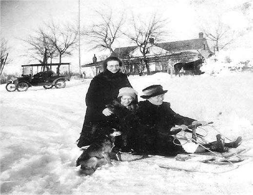 1922: Hazel, Violet and Mary Johnson sledding with Poly (dog) (Last photo of Mary Johnson before her death)