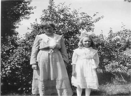 Mary Johnson and her daughter Vivian in their front yard near the intersection of Forker and Judkins Roads