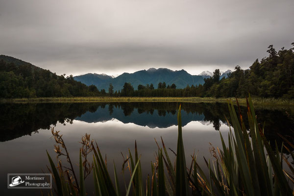 amazing mirror lake in front of a mountain scenery at lake matheson