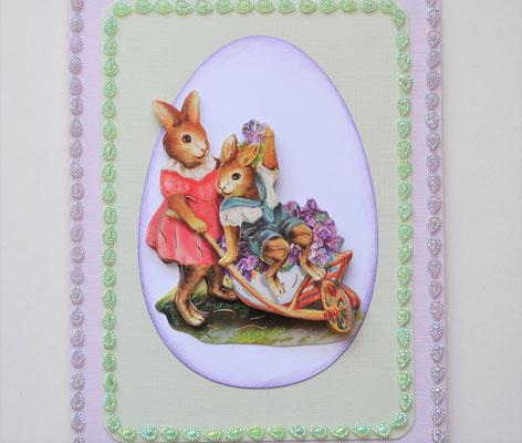 Osterkarte Hase im Schubkarren flieder-grün mit Schmucksteinen