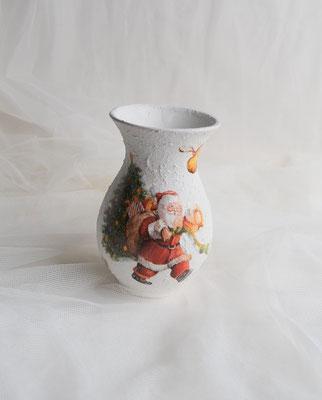 Diese Vase ist aus Keramik und ist als Teelicht gestaltet.