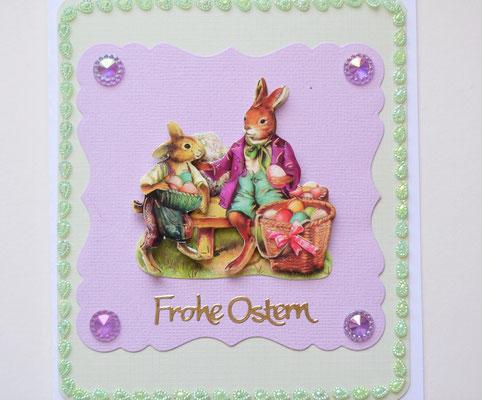 Osterkarte Hase mit Osterkorb flieder-grün mit Schmucksteinen