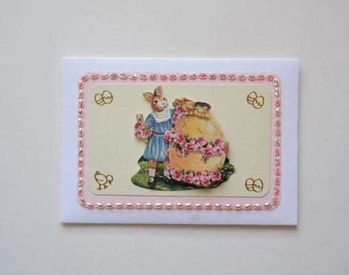 Osterkuvert weiß-rosa-gelb Hase mit Osterei