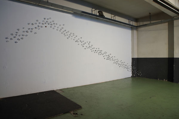 Butterfly Effects, 2008, silver enamel on paper, 210 elements, ASSAB ONE, Milano, photo Agostino Osio