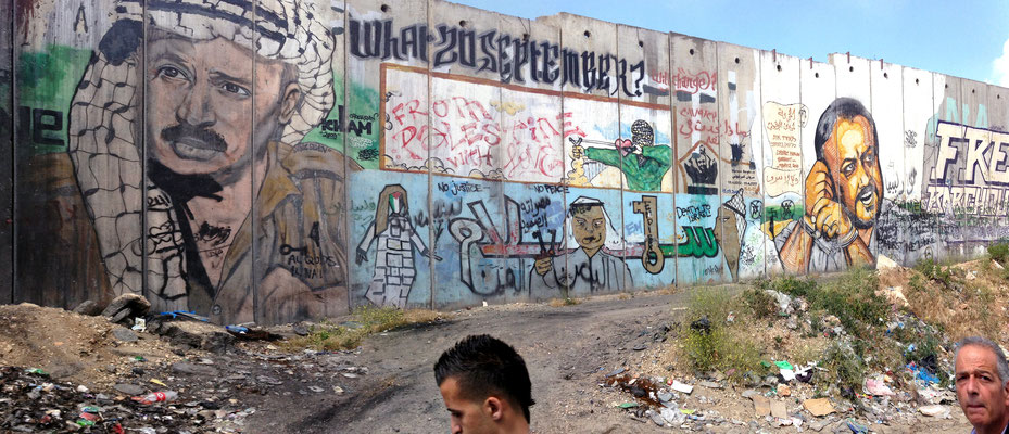 Figure 3. The separation barrier approaching the Qalandiya checkpoint features large murals of Yasser Arafat and Marwan Barghouti. The image was recorded from the number eighteen bus, which runs between central Ramallah and East Jerusalem, during October