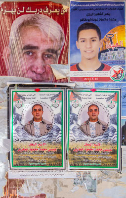 Figure 2. The lower and upper left posters are of prisoners. The upper right is Mohammed Abu al-Thahir who became shaheed on Nakba Day, May 15, 2014. Picture taken June 2014.