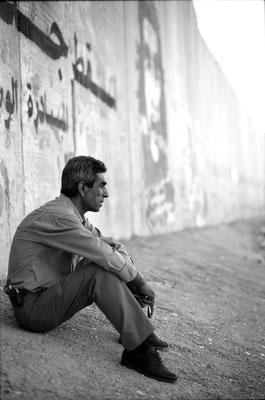 In Abu Dis my driver took a break in the shadow of the separation barrier. He later urged me to explore a nearby opening in the wall, which resulted in questioning by Israeli soldiers. June, 2006