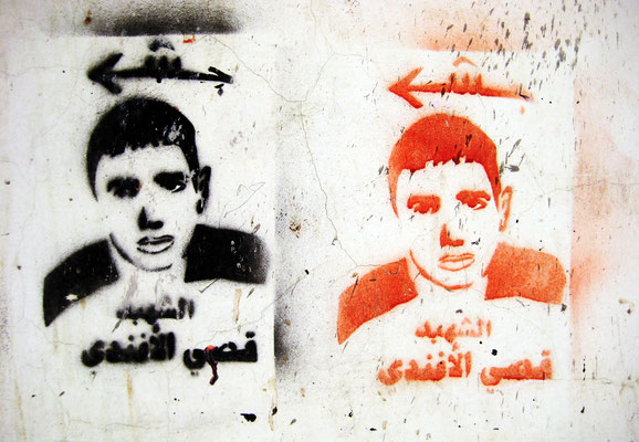 Figure12. Shaheed stencils of Qussay Al-Afandi. As reported by the Ma'an News Agency on January 28, 2008, Al-Afandi, age 17, was killed by a bullet wound to the stomach sustained during a clash with Israeli Defense Forces in Bethlehem. Photograph taken Ju