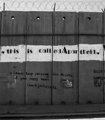 In 2009 the separation barrier in Al-Ram featured an open letter from South African political activist Farid Esack. Stenciled on three kilometers of the wall by Palestinian activists, it addresses the Palestinian people and the world. June, 2009