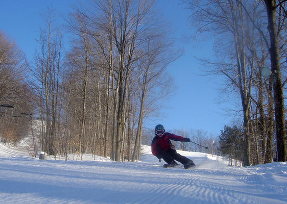 First and foremost Caberfae means great skiing. The resort prides itself on providing pristine snow groomed to perfection. Here a skier carves some arcs on Number One.