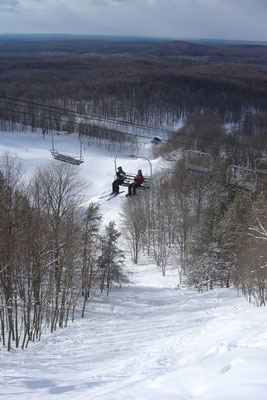 Caberfae peaks boasts the two highest lift-served peaks in the lower peninsula. A look from the North Peak chair shows the I-75 run leading to the base of South Peak.