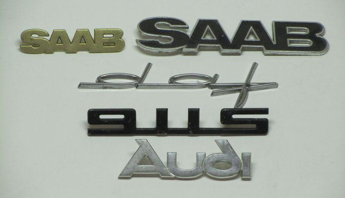Saab, Daf, Porsche en Audi emblemen.