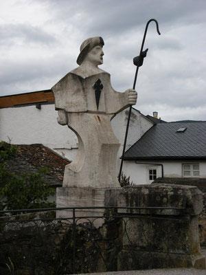 Le pélerin à la sortie de la ville