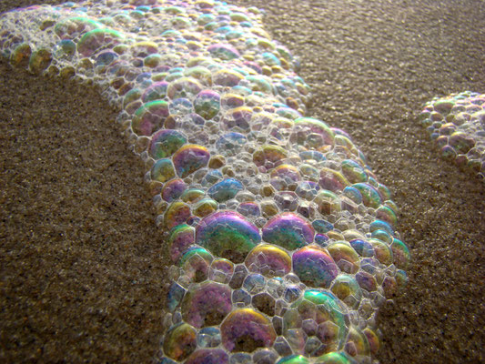 Coloured foam on the beach © Marlon Paul Bruin 2009