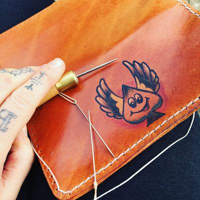 tattooed wallet