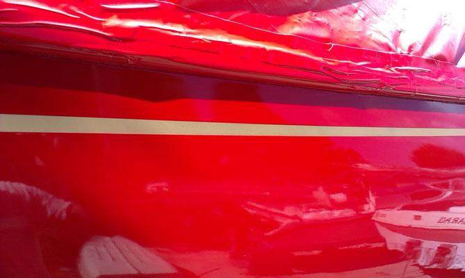 Awlgrip Sunfast Red spraygun finish on topsides