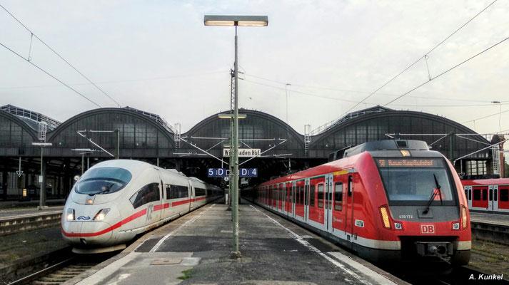 Regelmäßig kommt es in Wiesbaden Hbf zum direkten Aufeinandertreffen von S-Bahn und ICE. Am 25. August 2017 ist es 430 172 und ein 406 der Niederländischen Staatsbahn (Handyfoto).