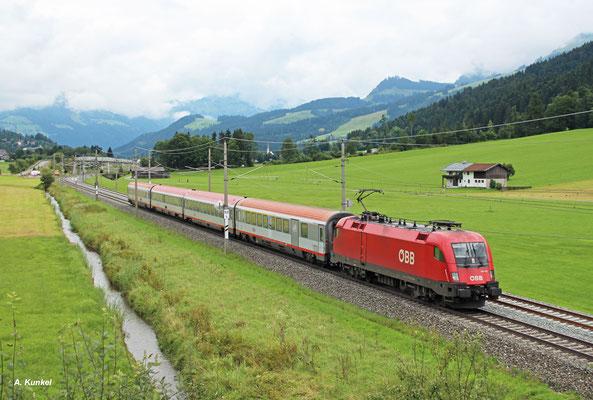 1116 128 ist am 06. August 2016 mit IC 542 Flughafen Wien - Innsbruck unterwegs. Letzter Halt vor wenigen Minuten war Kitzbühel.