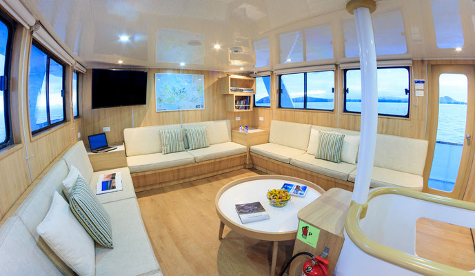 Galapagos Shark Diving - lounge area of the vessel of the dive liveaboard