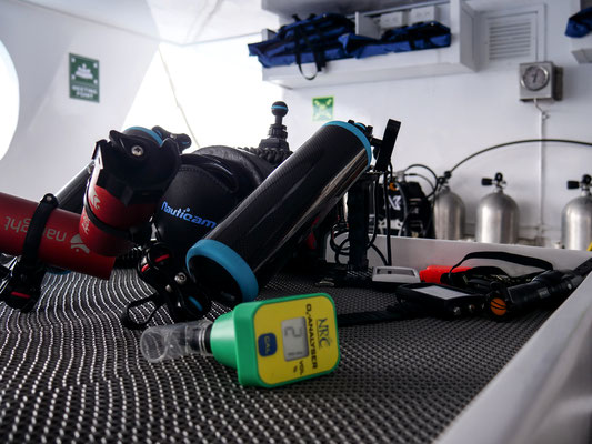 Equipment on the table of the dive deck of the vessel Galapagos Dive Expedition