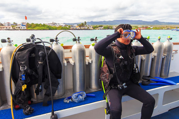 Diver getting ready on the dive deck of the vessel Galapagos Dive Expedition