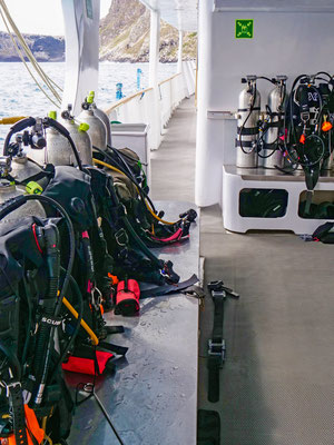 Tanks and equipment on the dive deck of the vessel Galapagos Dive Expedition