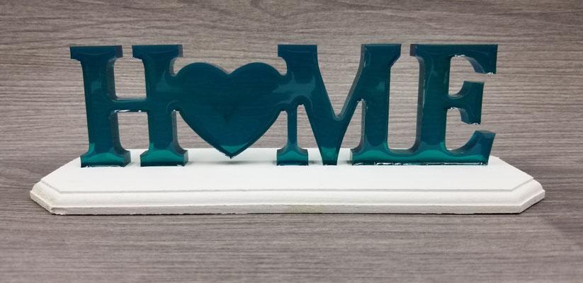 Home turquoise sur plaque de bois blanc 25$