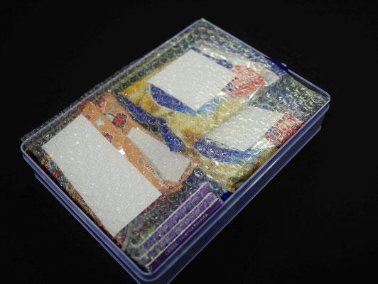 Z-50カット品(小粒)を贈答品用など缶に詰めたお菓子の緩衝材として使用した様子。