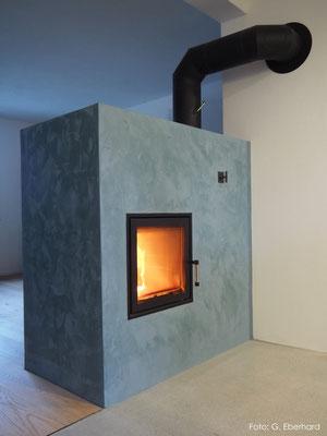 Kalkstucco auf gemauertem Ofen, Igis