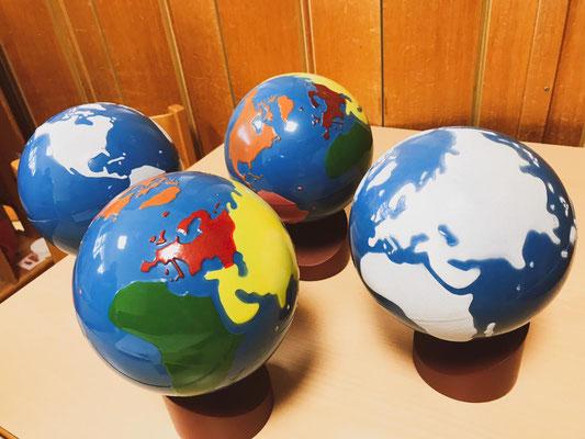 div. Globus mit Erdteilen etc.