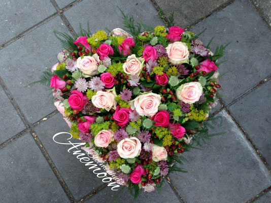 Rouwhart roze rozen