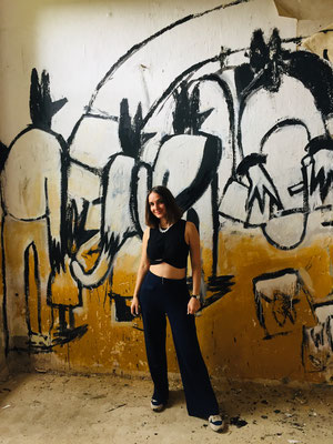 Bernadette Schweihoff in front of her mural for Artbase Festival 2019