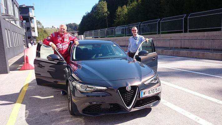 Rennleiter Herbert Leitner und Christian Danner begeistert nach einigen Runden im Renntempo mit der neuen Alfa Romeo Giulia