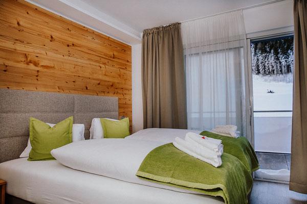 Schlafzimmer Appartement Kaibling mit Aussicht auf die Piste