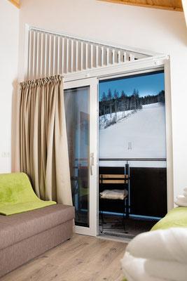 Schlafzimmer 2 Appartement Planai: für bis zu 3 Personen  mit AUssicht zur Piste