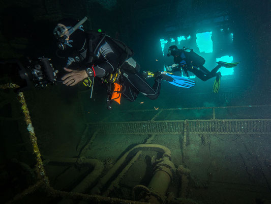 Divers in the Engine room of the Umbria wreck