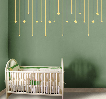 Hanging stars over a cot is safe and adds personality to the room.