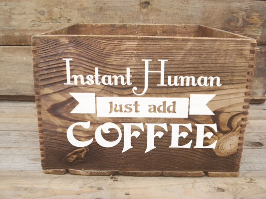 Instant Human Just Add Coffee vinyl sticker on a wooden gift box.
