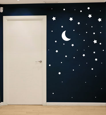 Stars and Moon stickers on a feature wall making a bold impact in this boy or girl's bedroom.