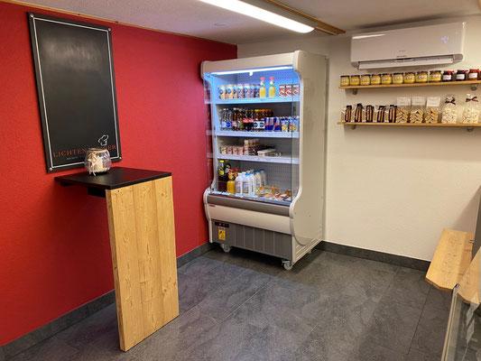Umbau Bäckerei Rückwand Architektur rote Wand